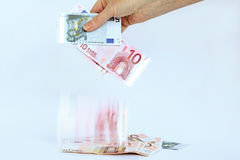 Quick euro. It is not good to be economical money too fast Royalty Free Stock Photo