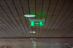Quick exit from the building, exit sign royalty free stock image
