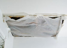 Quick fix of collapsed ceiling panel, closeup Stock Image