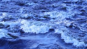 A quick flow of water and foamy waves. stock video footage
