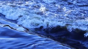 A quick flow of water and foamy waves. stock footage