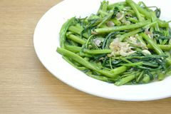 Quick-fried water spinach with chili and soy sauce Stock Image