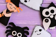 Quick Halloween crafts. Felt witch, ghosts, owl, spider decor on a wooden table. Felt Halloween handmade decor set Stock Images