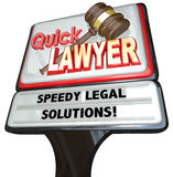 Quick Lawyer Attorney Speedy Legal Solutions Sign Advertising. Quick Lawyer sign advertising a law firm of attorneys promising speedy legal solutions to your Stock Photo