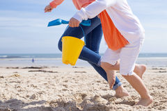 Quick lets build sandcastles! Stock Images