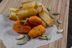 Quick light snack. Croutons and baked carrots Stock Photos