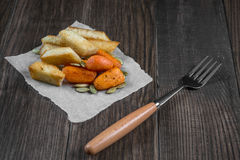 Quick light snack. Croutons and baked carrots Royalty Free Stock Image