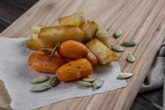 Quick light snack. Croutons and baked carrots Royalty Free Stock Photos