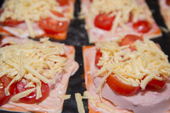 Quick mini pizzas ready for baking. A small pizza can be cooked quickly Royalty Free Stock Photos