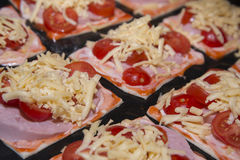 Quick mini pizzas ready for baking. Stock Photography