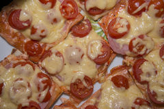 Quick mini pizzas are ready. royalty free stock images