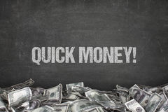 Quick money  text on black background Royalty Free Stock Photography