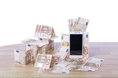 Quick mortgages. On white background. Banknotes and telephone on wood. Quick mortgages. On white background Royalty Free Stock Photos