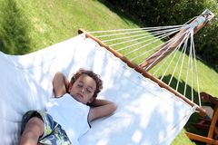 Quick nap on the hammock stock image
