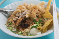 Quick noodle topping with Thai fried wonton, pork snack and pork royalty free stock photo