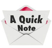 Quick Note Words Message Letter Message News Update. A Quick Note words on a letter or notecard in an open envelope to illustrate important news or information Royalty Free Stock Image