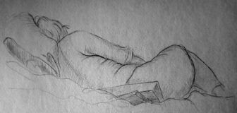 A quick pencil sketch of a woman lying in clothes. View from the back. stock images