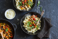 Quick ratatouille pasta. Delicious vegetarian healthy food concept. On a dark background. Top view Royalty Free Stock Image