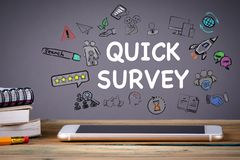 Quick survey, Media Technology concept. Mobile phone on a wooden table and a gray background stock image