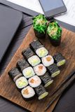 Quick sushi lunch in the office Stock Photos