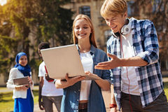 Quick witted energetic guy sharing her vision with her friend. Whats your spin on that. Productive admirable clever men meeting her fellow student and asking for stock photography