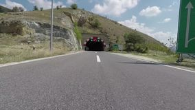 Quickly drive a motorcycle on the road and enter the tunnel. Quickly drive a motorcycle on the highway and enter the tunnel stock video footage