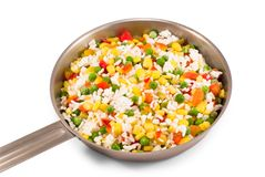 Quickly frozen vegetable mixture in frying pan Stock Photos