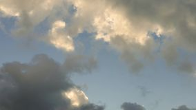 Quickly passing white clouds, time lapse stock footage