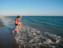 Quickly run to swim! stock photo
