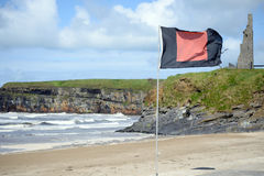 Quicksilver flag flying beside castle Royalty Free Stock Photos