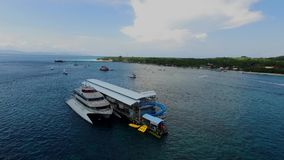 Cruise ship landed in Nusa Pendia water sports, with blue sky background. Quicksilver Silversonic boats taking tourists on Lembongan to Nusa Penida, snorkeling stock footage