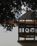 Quiet Afternoon Gazebo. It`s very quiet and peaceful on this misty, foggy afternoon at the Whale`s Head Hunting club in Duck, North Carolina royalty free stock photo