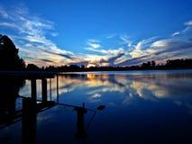 Clouds inside the lake: a peaceful dusk stock photos