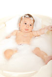 Quiet baby boy in water tub Royalty Free Stock Photography