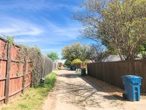 Quiet back alley in residential area near Dallas, Texas royalty free stock image