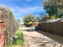 Quiet back alley in residential area near Dallas, Texas royalty free stock photo