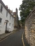Quiet back street leading up to Lincoln Cathedral. Quiet back steps leading up to Lincoln Cathedral - along one side is a brick wall adorned with lovely climbing royalty free stock photos
