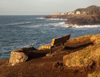 The quiet bench. A lone bench on the Oregon Coast near Depot Bay provides a beautiful scene and quiet reflection Stock Images