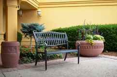 Quiet bench out front Stock Photography