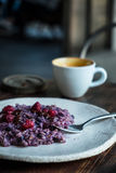 Quiet breakfast. Blueberry blended oatmeal porridge with raspberries and chocolate chips Royalty Free Stock Images