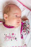 Quiet and calm baby is lying on blanket.  Stock Image