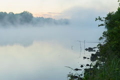 Quiet calm early morning on lake in summer. Magic dawn with fog. Concept of seasons,ecology, environment, natural Royalty Free Stock Photo