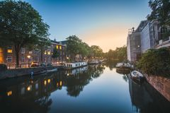 Quiet canal in Amsterdam, Netherlands at sunset royalty free stock images