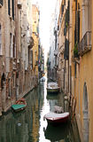 Quiet canal in Vencie. Quiet narrow canal with tied up boats in Venice Stock Photos