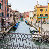 Quiet canal in Venice Italy. With moored boats at Piazza Roma. Venice spreads over 100 small islands and has 150 canals and over 400 bridges Royalty Free Stock Photo