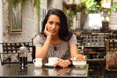 Quiet coffee moment for young beautiful woman Royalty Free Stock Image