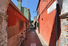 A quiet colorful alley in Venice, Italy Stock Photos