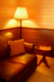 Quiet Corner. A warm,quiet corner ,a soft leather lounge, and soft warm light. A beautiful place to be on a cold night Stock Images