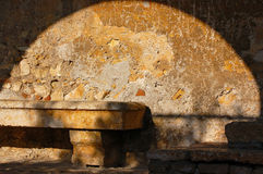 Quiet Corner. Old stone bench - concept of peace and inner stillness Royalty Free Stock Photos