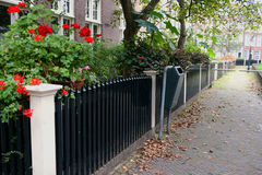 Quiet courtyard in Amsterdam. Fence houses in a quiet courtyard in Amsterdam Royalty Free Stock Images